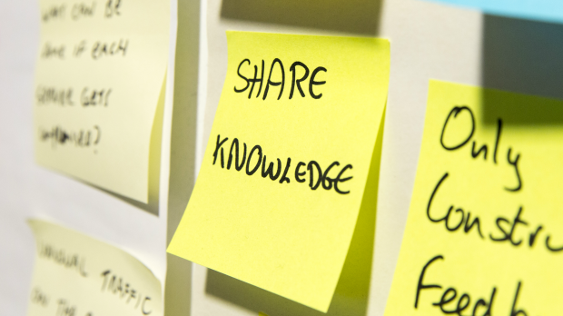 Post-it note saying Share knowledge